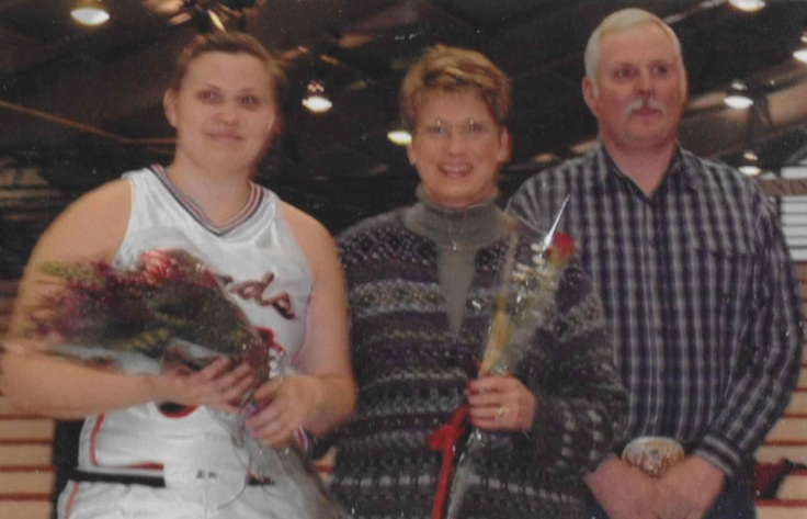 Erin with her parents on senior night at Haverford College